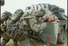 military, soldiers behind tank assault - stock footage