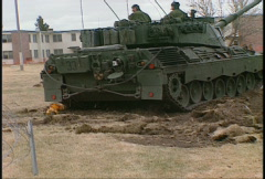 Military, leopard tanks tearing up the ground, urban enviroment Stock Footage