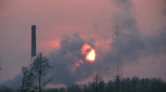 Sunset through smoke from chemical plant 4 Stock Footage