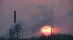 Sunset through smoke from chemical plant 5 Stock Footage
