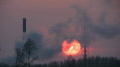 Time-lapse of sunset through smoke from chemical plant 6 Stock Footage