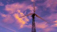 Wind turbine against drastic sky timelapse - HD  Stock Footage