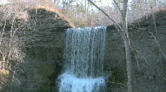 Waterfall on eroded limestone rock Stock Footage