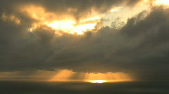 Sun behind clouds - stock footage