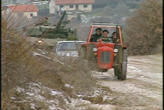 Kosovo, former Yugoslavia. tractor and family Stock Footage