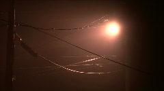 Street Lights & Power Lines On Misty Night Stock Footage