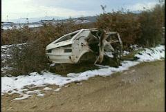 Stock Video Footage of Kosovo, former Yugoslavia. destroyed car