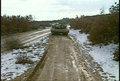 Stock Video Footage of Kosovo, former Yugoslavia. Leopard tank on patrol, #1