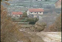 Stock Video Footage of Kosovo, former Yugoslavia. Leopard tank on patrol, #15