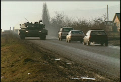 Stock Video Footage of Kosovo, former Yugoslavia. Leopard tank on patrol, #26