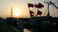 Stock Video Footage of 'Fishing net buoy flags at sundown