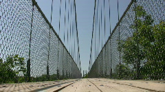 Suspension bridge crosses over the treetops (High Definition) Stock Footage