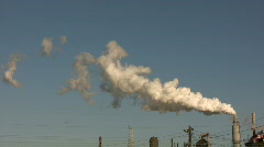 Large chimney is exhausting a long trail of fumes. Stock Footage