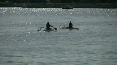 Couple are kayaking on a beautiful sparkling lake (High Definition) Stock Footage