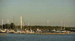 Small boat marina rests in the distance (High Definition) - stock footage