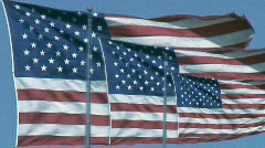 3 flags on a very windy day - comp Stock Footage