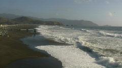 Ocean waves wash up on the sunny San Francisco beach Stock Footage
