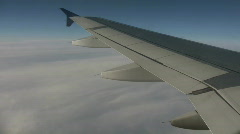 Airplane wing sways in wind on sunny day (High Definition) Stock Footage