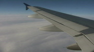 Stock Video Footage of Airplane wing sways in wind on sunny day (High Definition)