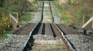 Railway tracks head off into the sunny distance (High Definition) Stock Footage