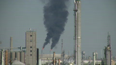 Stock Video Footage of Black fumes spill out of large chimneys at Houston Refinery