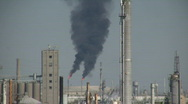 Black fumes spill out of large chimneys at Houston Refinery Stock Footage