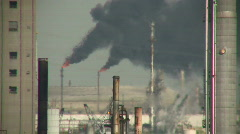 Black fumes spill out of large chimneys at Houston Refinery - stock footage