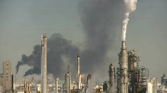 Stock Video Footage of Fumes spill out of large chimneys at Houston BP Refinery