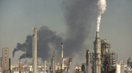 Fumes spill out of large chimneys at Houston BP Refinery Stock Footage