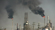 Black fumes billow from burning chimney fires at Houston Refinery Stock Footage