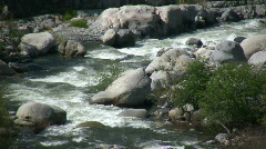 Kaweah River flows downstream through the rocks, creating whitewater rapids - stock footage