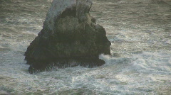 Ocean waves crash against the rocky outcrops Stock Footage