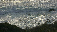 Rough ocean waves crash against the rocky San Francisco shoreline Stock Footage
