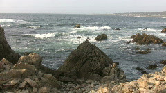 Ocean waves crash against the Californian rocky outcrops Stock Footage