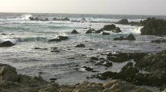 Rough ocean waves crash against the rocky California shoreline Stock Footage