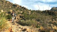 Hiker in desert terrain V2 - HD  Stock Footage