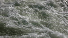 Closeup of the rough waters of the Kaweah River Stock Footage