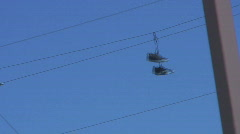 Tennis shoes on a wire - stock footage