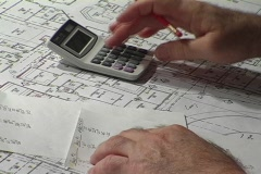 Calculator and Pencil Over Schematic Drawings Stock Footage