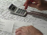 Stock Video Footage of Calculator and Pencil Over Schematic Drawings