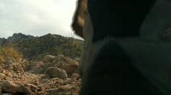 Hiker in desert terrain V4 - HD  Stock Footage