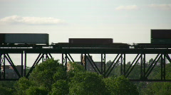 Silhouette of a freight train moving down tracks (High Definition) Stock Footage