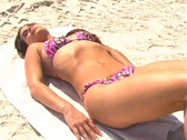 Stock Video Footage of Bikini-clad Brunette on the Beach-1k