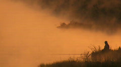 fisherman on morning fishing. - stock footage