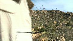 Hiker in desert terrain V5 - HD  Stock Footage