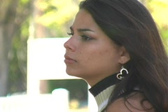 Beautiful Brunette Walking Outdoors (close-up) Stock Footage