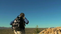 Victorious hiker on cliff - HD  Stock Footage