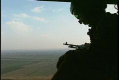 Kosovo, former Yugoslavia helicopter flight, #6 door gunner Stock Footage