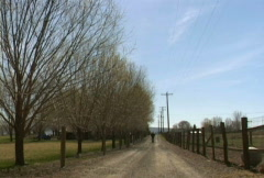 Man Walks Up Old Country Road Stock Footage
