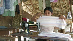 Burma: Woman Sews Stock Footage